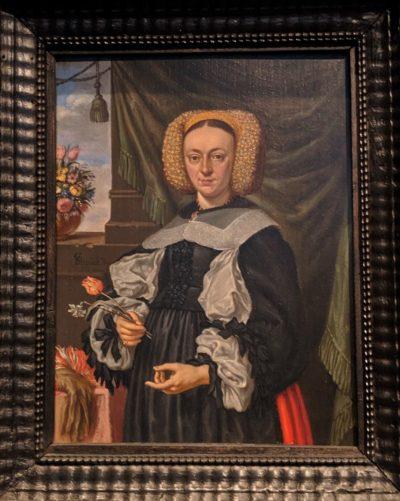 「花を持つ女」(1664)